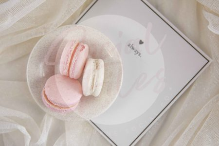 Valentine's Day flatlay with Always greeting card, pink and white macaroons on white fabric - watermarked.
