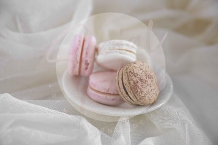 Valentine's Day flatlay with brown, pink and white macaroons on white fabric - watermarked.