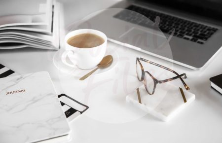 Laptop, diary, glasses, coffee on white desk flatlay #2 (watermarked)