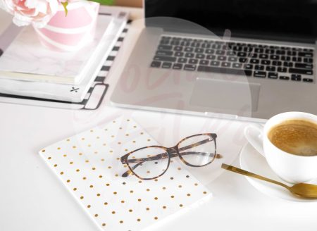 Laptop, diary, glasses, coffee and pink flowers on white desk flatlay. (watermarked)
