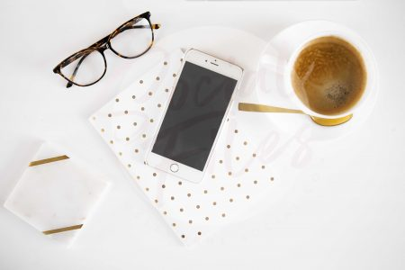 Iphone, diary, glasses, coffee on white desk flatlay #1 (watermarked)