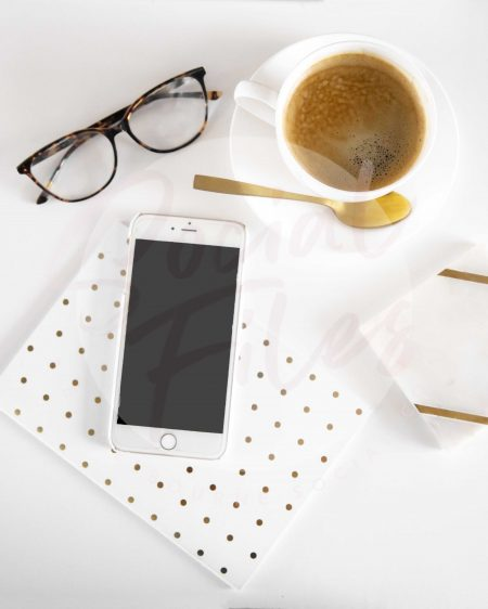 Iphone, diary, glasses, coffee on white desk flatlay #2 (watermarked)