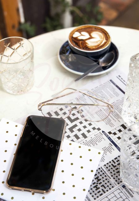 iPhone on marble table with newspaper, coffee and glasses 02 (watermarked)