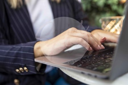Woman typing on laptop 02 (watermarked)